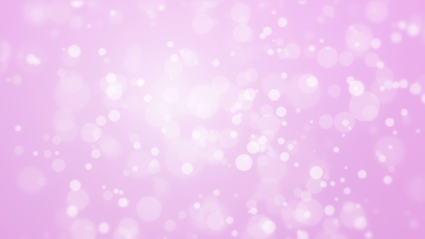 Illuminated glowing purple pink bokeh background with floating light particles.   Shutterstock HD Video #1031990546