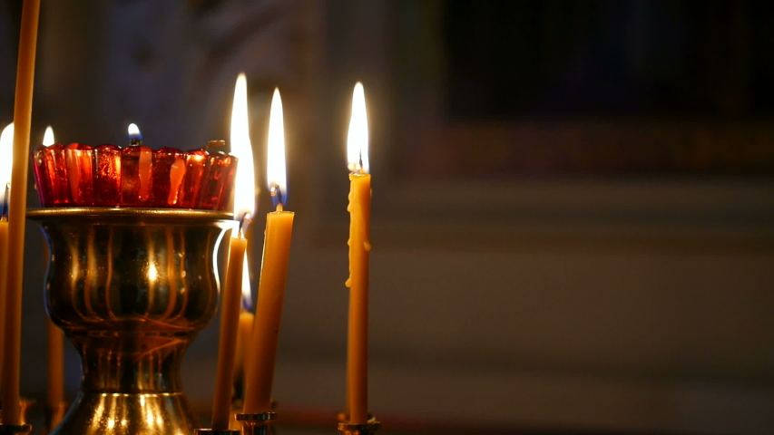 Burning candles in an Orthodox Church. Soft candlelight.   Shutterstock HD Video #1032022946