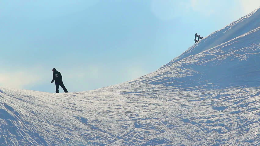 Guys riding snowboards in Alpine mountains, extreme sport | Shutterstock HD Video #10320296