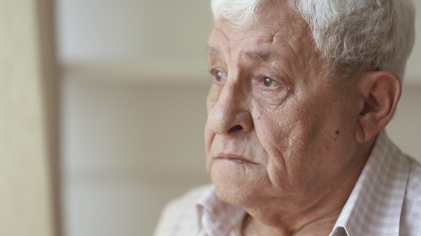 Pensive elder senior man looking away feel upset, thoughtful melancholic older retired gray haired grandpa suffer from sorrow grief loneliness, sad grandfather widower alone at home, close up view | Shutterstock HD Video #1032303716