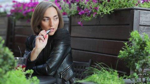 young beautiful woman enjoying the e-cigarette