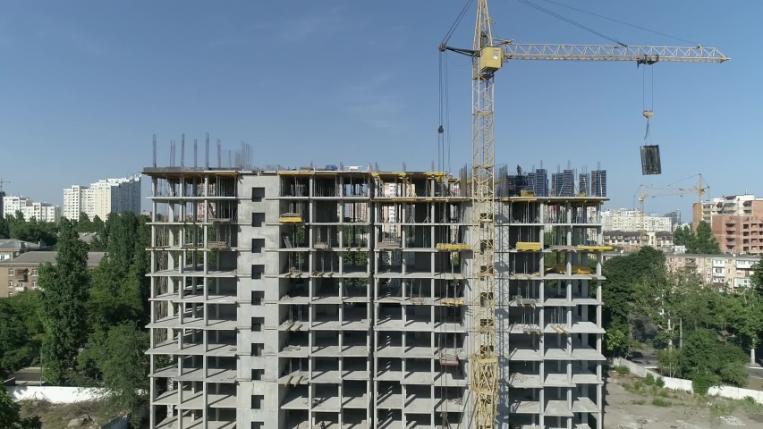 Aerial view of high rise residential complex under construction. Construction of apartment building in green zone. Multi-storey modern residential complex under construction | Shutterstock HD Video #1032637106