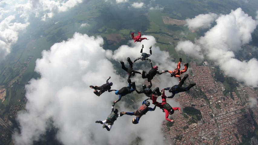 Skydivers having fun in the sky | Shutterstock HD Video #1032686576