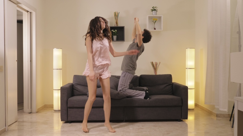 Fun ,Joy,Happiness.Carefree Young lovers dancing in the morning at home   Shutterstock HD Video #1032735146