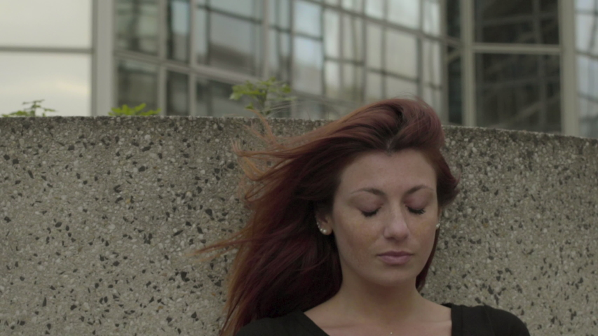 Sad Woman using smartphone Sitting in business district, worried while texting with mobile telephone outside, typing text message on cell phone. Paris, Red hair. Social media. Slow Motion close up. | Shutterstock HD Video #1032739646