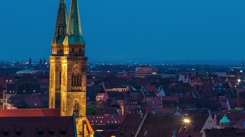 NUREMBERG, GERMANY – May 24, 2015: Church and old town in the evening timelapse - a view on the old town nuremberg and St. Sebald church from evening to night time lapse, pan shot