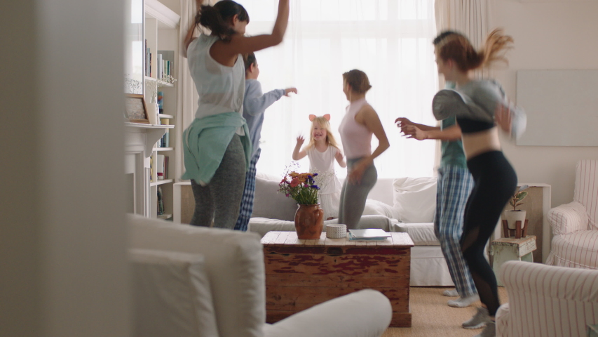Happy multiracial family dancing at home having fun enjoying dance celebrating exciting weekend together wearing pajamas | Shutterstock HD Video #1032902936