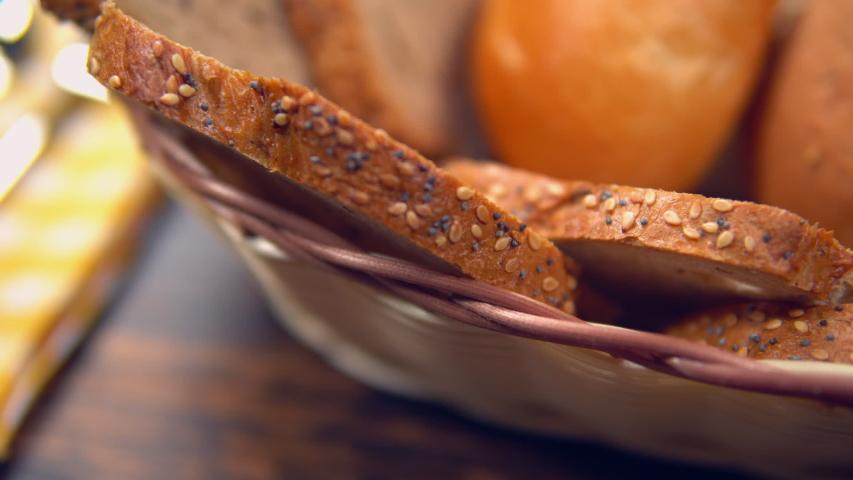 Close up crisp bread in breadbasket   Shutterstock HD Video #1033001876