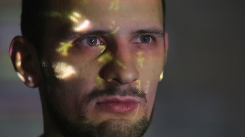 Hacker's face with symbols from the monitor | Shutterstock HD Video #1033042496