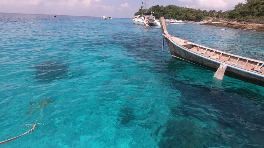 Blue sea with blue skies and long tail boats in summer in Phuket, Thailand #1033093766