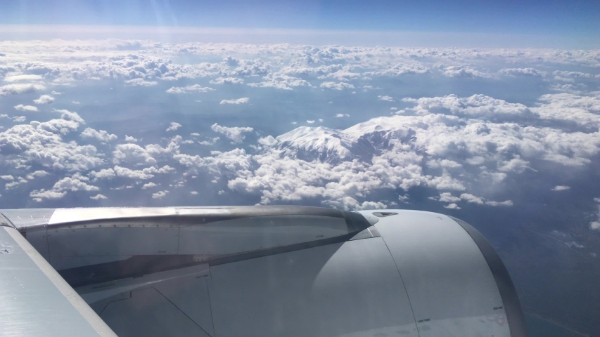 turbine view from an airplane flying above the clouds and the snowed mountains of Alps in Europe 2 #1033233626