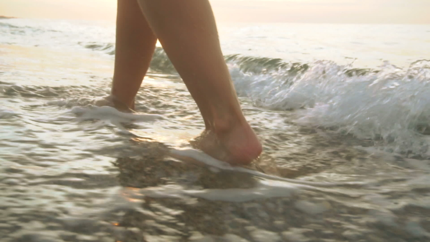 Track shot on the woman's legs while walking in the beach | Shutterstock HD Video #1033375136