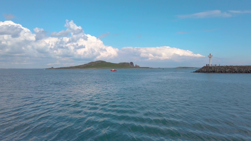View towards the island Irelands's Eye and Howth lighthouse   Shutterstock HD Video #1033462556