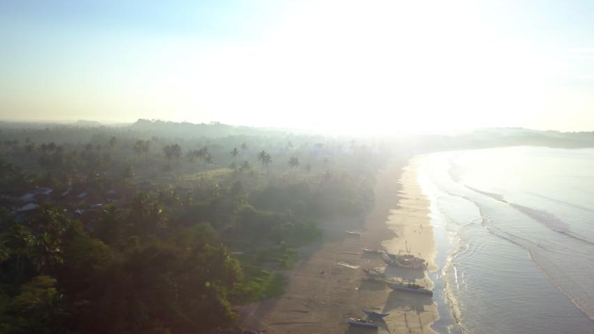 Rotating aerial shot of Weligama Beach, Sri Lanka at sunrise. #1033534556