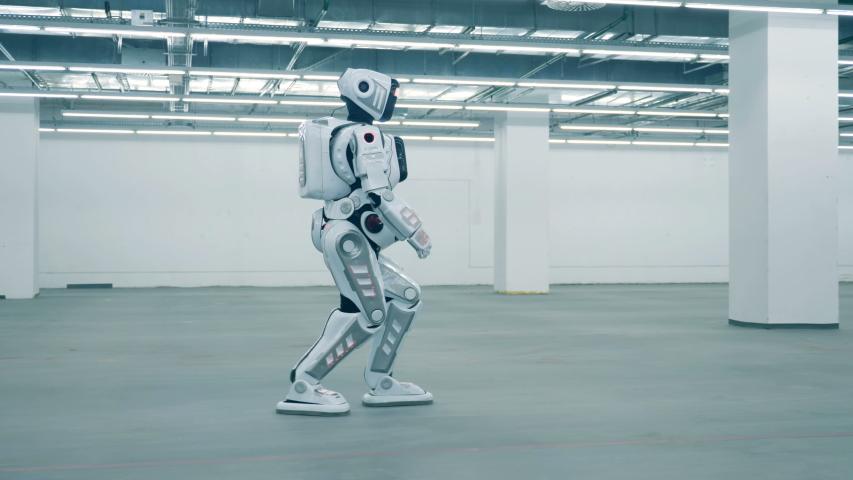 Modern cyborg walking in a room, side view. | Shutterstock HD Video #1033569686