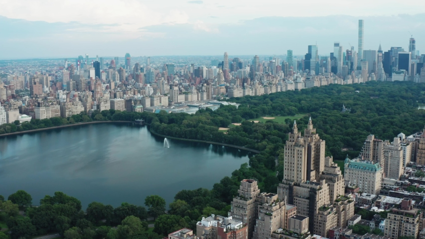 New York City, NY/USA - 07.09.2019: View on Central Park, buildings and skyscrapers from air. Aerial cityscape view of Manhattan from a drone.