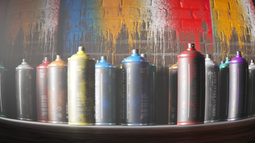 Countless, used, colorful spray paint cans standing in front of a old, painted, brick wall. Saturated splatter stains and leaks in endless loop. Low camera moving sideways in looping animation.  | Shutterstock HD Video #1033790636
