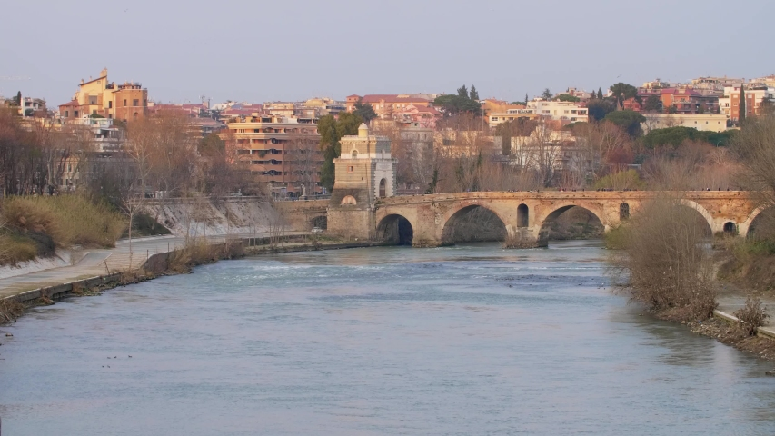 A wide shot of people crossing Ponte Milvio, Rome | Shutterstock HD Video #1033806806