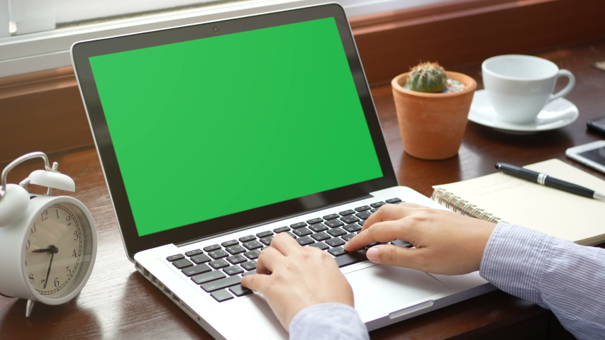 4K. close-up woman working with laptop computer, using finger with keyboard and touchpad or trackpad for slide. computer laptop with blank green screen chroma key. | Shutterstock HD Video #1033846946