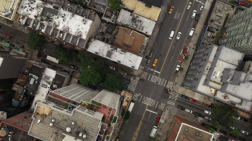 NEW YORK - JULY 16, 2019: slow aerial flyover over cars driving on city street in Manhattan New York City NYC. | Shutterstock HD Video #1033942706