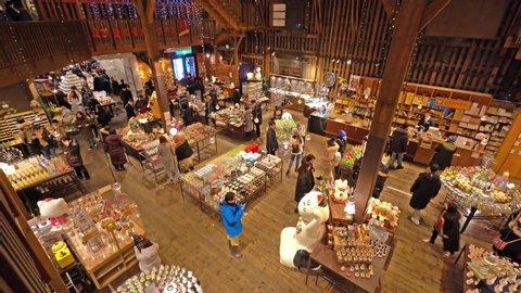 Hokkaido, Japan - 04 08 2019: Otaru Hokkaido Japan - Circa People mill around the gift shop at Otaru Music Box Museum, Otaru,Japan