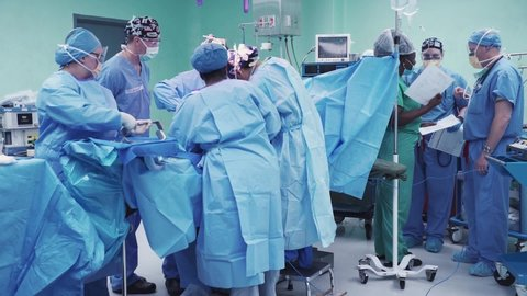 CIRCA 2010s - A team of U.S. Air Force service members perform a hysterectomy surgery during New Horizons exercise.