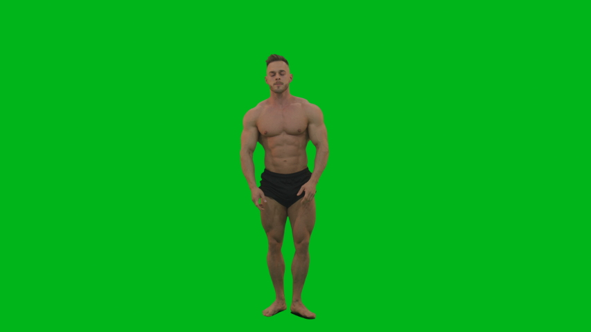 Young man fitnes trainer bodybuilder posing on green screen showing his muscules and biceps. Isolated on green background. 4K Video Footage | Shutterstock HD Video #1034169326