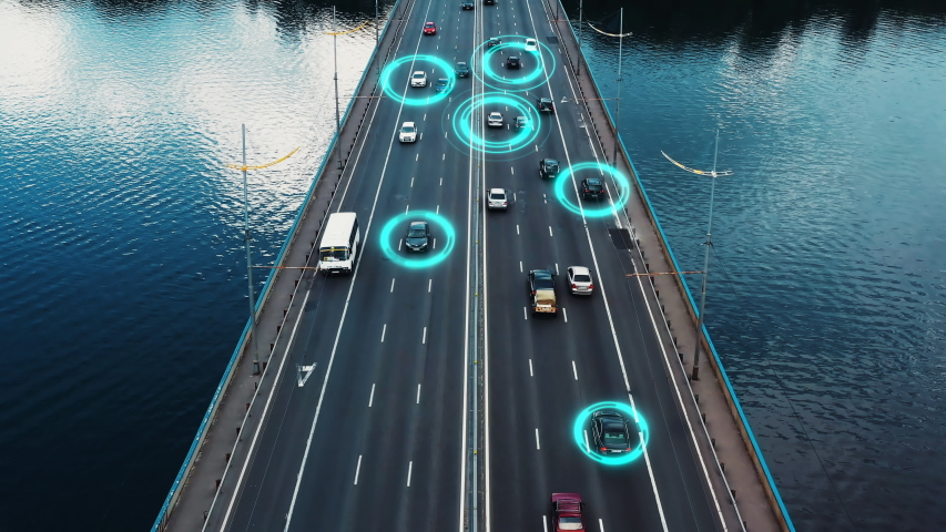 Self driving autonomous cars speeding through the bridge with technology scanning their speed. Artificial intelligence traffic surveillance system to provide safe driving avoid traffic jams. 4K aerial