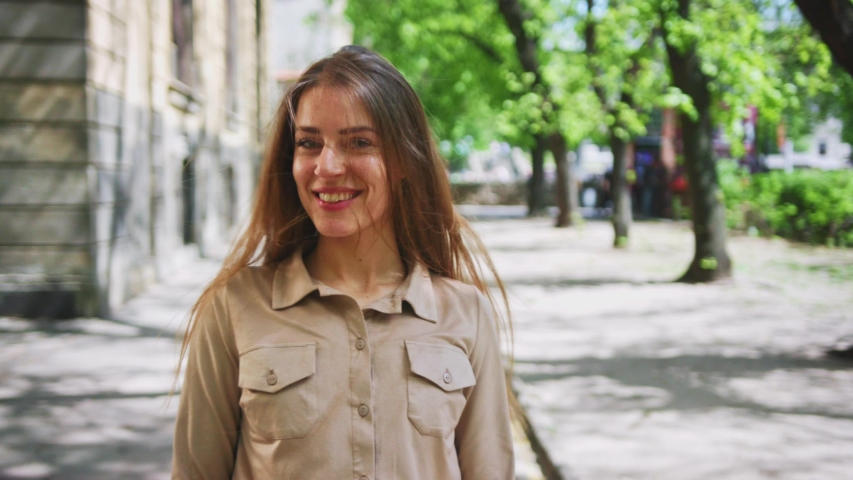 Beautiful elegant woman in fashion look walking in the street. Follow passionate caucasiona girl smiling flirting staying in gorgeous old city. | Shutterstock HD Video #1034296376