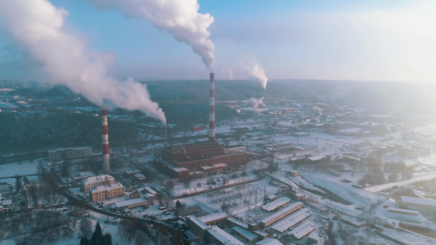 Aerial view of capital city central heating power plant in industrial district, Vilnius, Lithuania. During cold winter day. | Shutterstock HD Video #1034325926