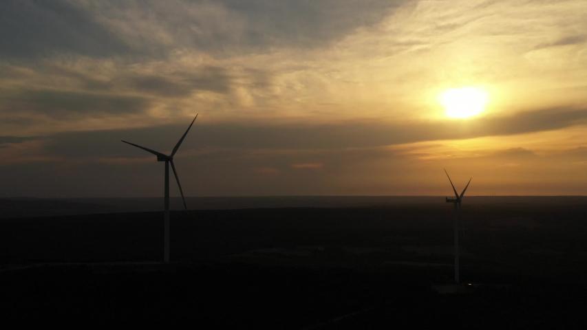 wind turbines generating green energy  #1034398346