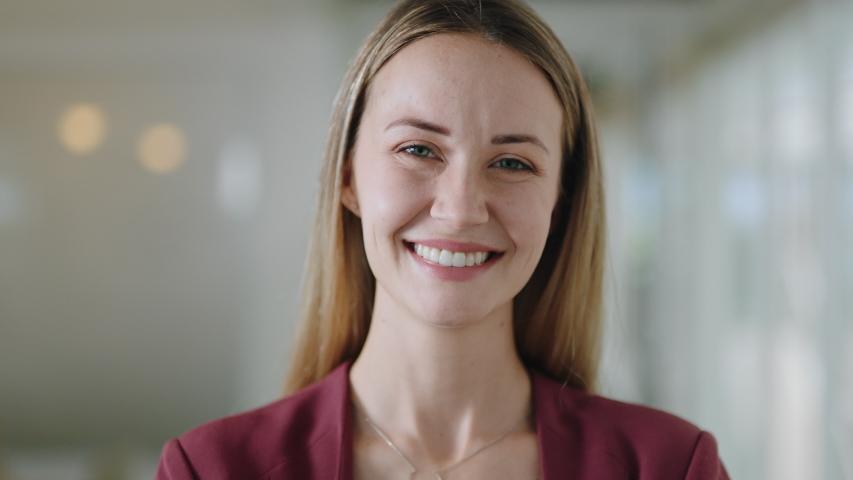 Portrait happy caucasian business woman smiling enjoying successful career proud entrepreneur in office workplace testimonial 4k footage | Shutterstock HD Video #1034450006