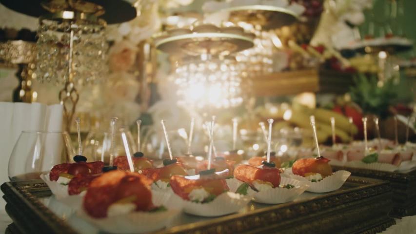 Beautiful rich buffet. Beautiful lighting. Close up. The camera is in motion.   Shutterstock HD Video #1034503466