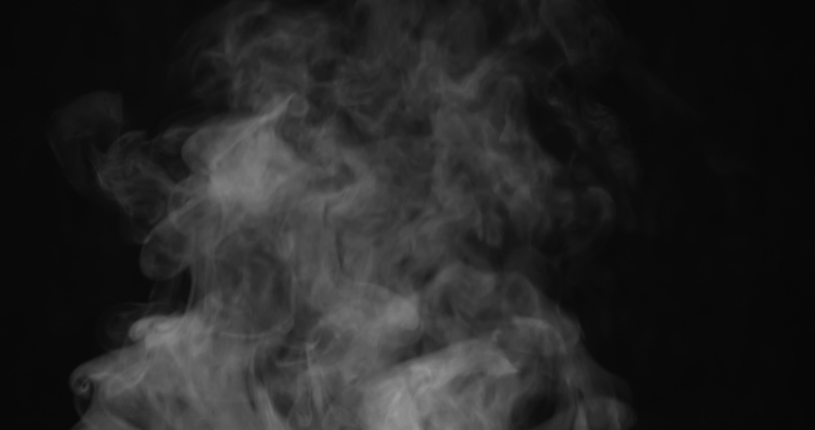 Boiling Water Pan Creates Steam. White Steam rises from a large pot that is behind the scenes. Black background. Filmed at a speed of 120fps #1034614706