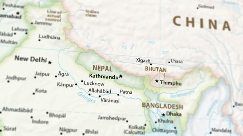 Nepal on a political map of the world. Video defocuses showing and hiding the map (4K UHD).