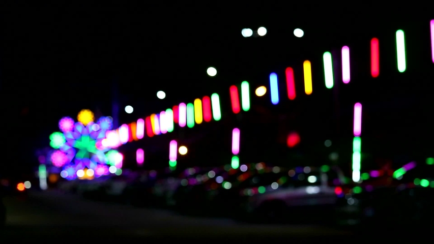 Blur neon light and silhouette car and people in night market fair parking area | Shutterstock HD Video #1034786516