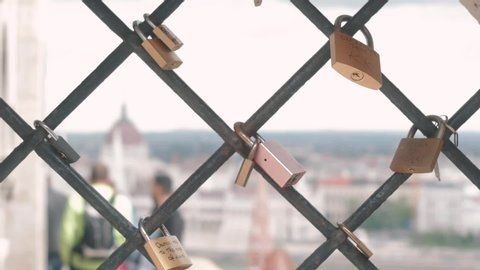 Many different romantic love locks close up ib Buda castle, the main attraction of the city of Budapest. St. Matthias Church