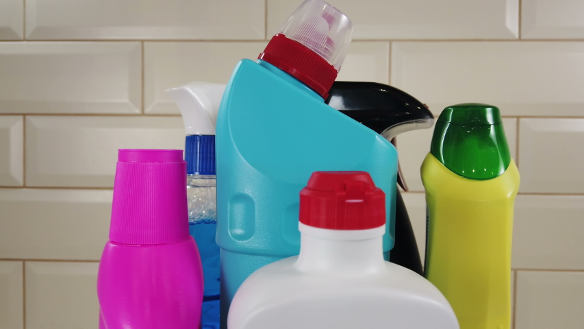 different products and items for cleaning on the floor in the kitchen. Concept cleaning. Rotation video