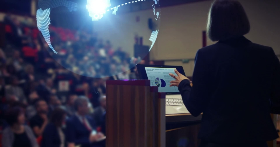 a woman holds a speech to the audience in an auditorium on a convention of economics and finance their business concept world economy futuristic conference holograms future business world #1034826926