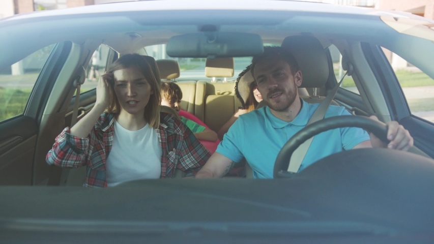 NEW YORK - April 5, 2018: Happy excited young family having a fun roadtrip in the city center. Front view of parents and kids riding a car as part of their summer tour. | Shutterstock HD Video #1034878286