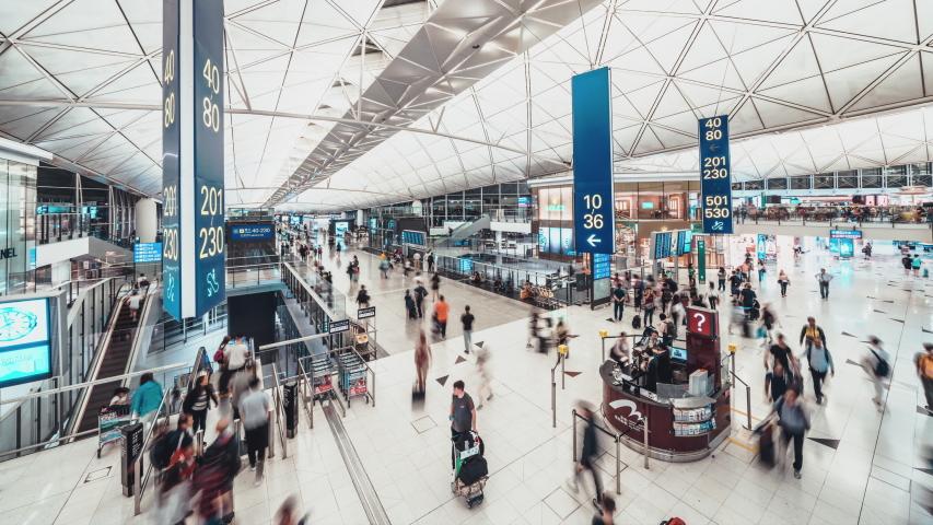 Hong Kong, Hong Kong - Jul 10, 2019: Time-lapse of crowded people walking in Hong Kong airport transit terminal. Air transportation, international tourism, travel abroad, or commuter lifestyle concept