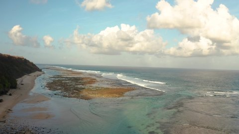Bali Indonesia Pandawa beach, most beautiful place in the world filmed stunning colorful sand and rock ocean. Drone footage in 4k.