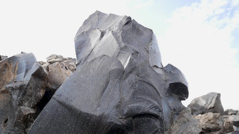 Black obsidian rock, a natural volcanic glass in Landmannalaugar. beautiful scenic nature landscape in Iceland