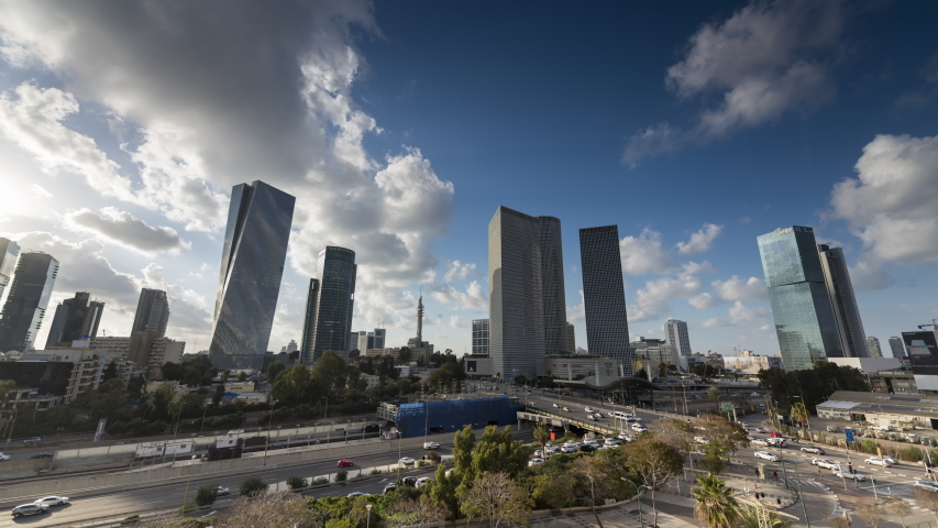 Aerial Time lapse day to night of tel aviv skyline with urban skyscrapers, beautiful moving clouds, Israel. zoom in effect | Shutterstock HD Video #1035173696