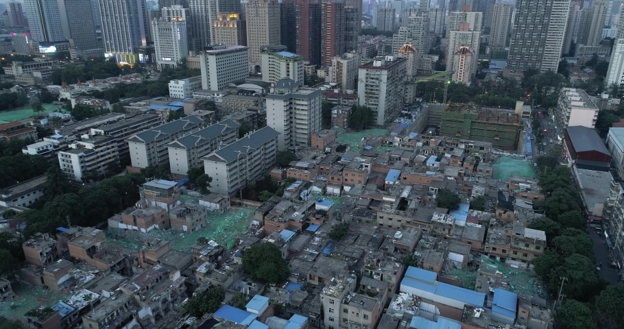 Aerial view from transforming urban villages to the whole city urban high buildings in Xian China concept of Chinese urbanization | Shutterstock HD Video #1035188426