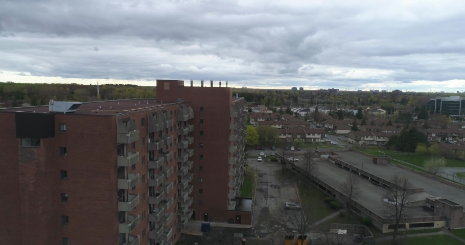 Drone flying past residential living building in urban area | Shutterstock HD Video #1035206516