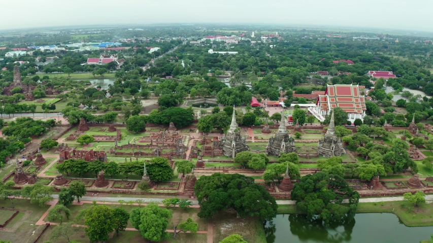 Aerial landscape of Ayutthaya historical park in Ayutthaya province of Thailand. Ayutthaya Historical Park has been registered as a UNESCO World Heritage Site.   Shutterstock HD Video #1035234836