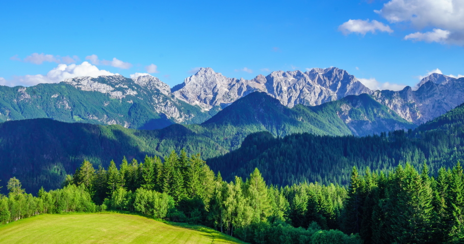Timelapse overlooking Julien Alps in Slovenia on a clear sky on summer #1035264116