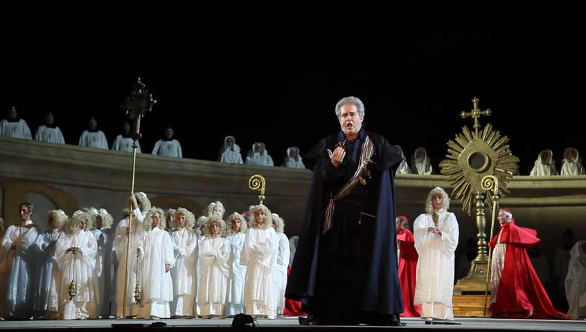 MASADA, ISRAEL - JUNE 01, 2015: Maestro Daniel Oren conducts on Giacomo Puccini's 'Tosca' opera during dress rehearsal. The Festival takes place at the foothills of Masada UNESCO World Heritage site.