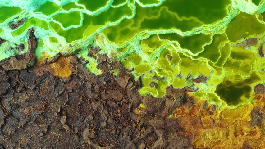 Overhead drone shot of crust of volcano filled with pools of minerals in Dallol, Ethiopia  | Shutterstock HD Video #1035592916